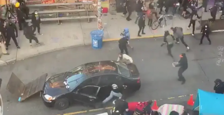 Man Drives Car Into Seattle Protesters, Shoots Demonstrator