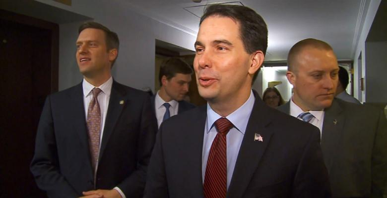 Walker Vows to Protect Pre-Existing Conditions While Fighting to Kill Protections
